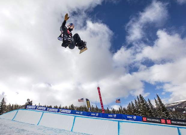 Toby Miller, of California, in midair at the Toyota U.S. Grand Prix World Cup halfpipe snowboard men's finals Saturday, Dec. 8, at Copper Mountain.