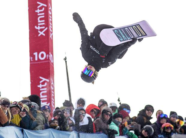 Maddie Mastro, of California, in midair of the Toyota U.S. Grand Prix World Cup halfpipe snowboard women's finals Saturday, Dec. 8, at Copper Mountain.