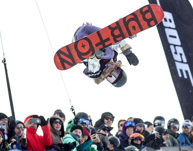 U.S. olympic gold medalist, Chloe Kim, wows the crowd in midair at the Toyota U.S. Grand Prix World Cup halfpipe snowboard women's finals Saturday, Dec. 8, at Copper Mountain.