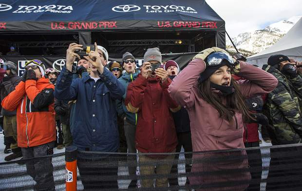 A fan in front without a cellphone reacts with others of Raibu Katayama's crash landing during the Toyota U.S. Grand Prix World Cup halfpipe snowboard men's finals Saturday, Dec. 8, at Copper Mountain.