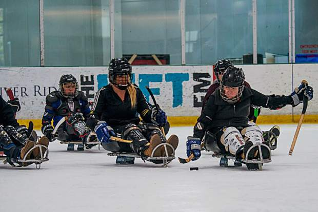 Chelsea Romo, 29, of Marietta, California took part in last week's The Hartford Disabled Sports USA Ski Spectacular, where she participated in sled hockey on Friday at the Stephen C. West Ice A rena in Breckenridge (third from left). Romo is a survivor of the October 2017 Las Vegas Shooting.