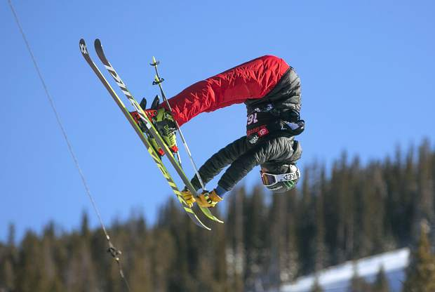 Toyota U.S. Grand Prix halfpipe freeski competitor and Breckenridge native Jaxin Hoerter grabs his ski tips high above the Copper Mountain Resort halfpipe as part of Tuesday training for Wednesday's Grand Prix freeski qualifying round.