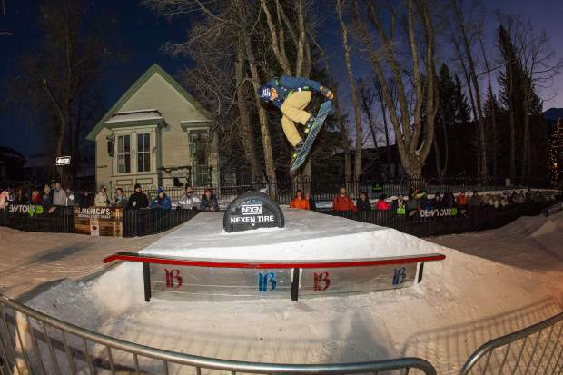 Snowboarder Ozzy Henning executes a trick during last year's Dew Tour Streetstyle event, which takes place annually on a man-made rail jam type course on Washington Avenue in downtown Breckenridge.