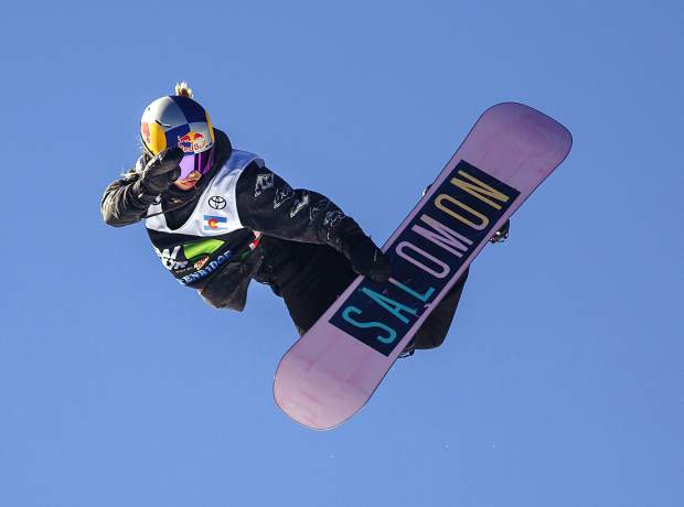 Maddie Mastro executes a trick in midair during Dew Tour's modified snowboard superpipe competition on Sunday, Dec. 16, at Breckenridge Ski Resort. Mastro finished in second place.
