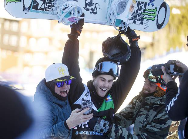 Stale Sandbech, of Norway, at right, reacts after winning Dew Tour's men's snowboard slopestyle competition on Sunday, Dec. 16, at Breckenridge Ski Resort.