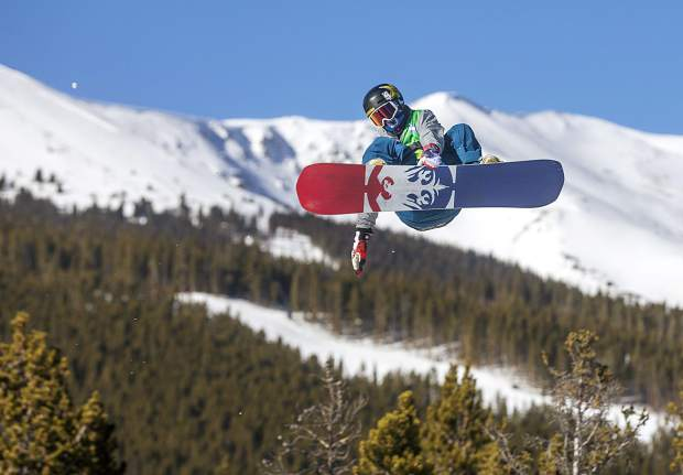 Chris Corning, of Silverthorne, executes a trick in midair during Dew Tour's snowboard slopestyle competition on Sunday, Dec. 16, at Breckenridge Ski Resort.