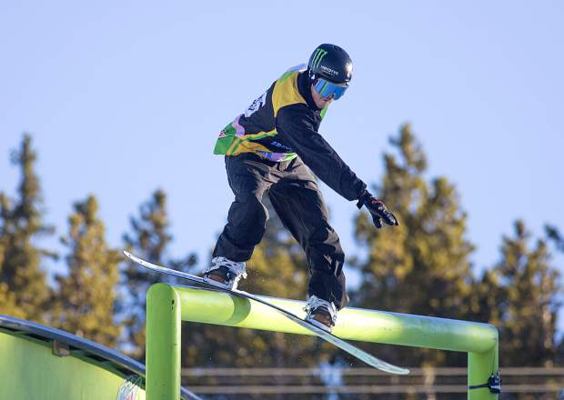 Stale Sandbech, of Norway, executes a trick on the rail during Dew Tour's snowboard slopestyle competition on Sunday, Dec. 16, at Breckenridge Ski Resort.
