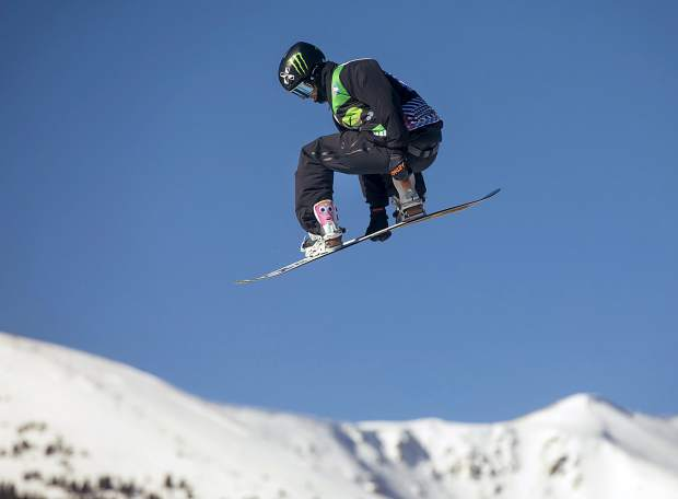 Stale Sandbech, of Norway, executes a trick during Dew Tour's snowboard slopestyle competition on Sunday, Dec. 16, at Breckenridge Ski Resort.
