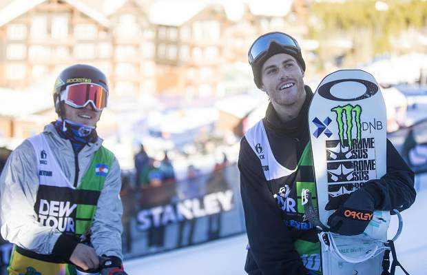 Stale Sandbech, of Norway, at right, watches the results of Dew Tour's snowboard slopestyle competition with Chris Corning, of Silverthorne, at left, on Sunday, Dec. 16, at Breckenridge Ski Resort.