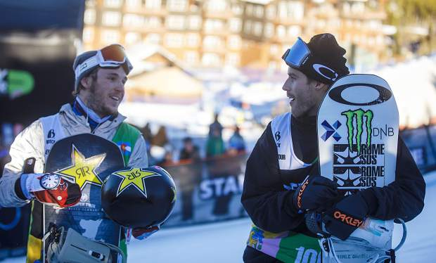 Stale Sandbech, of Norway, at right, reacts after finishing in first place at the Dew Tour snowboard slopestyle competition on Sunday, Dec. 16, at Breckenridge Ski Resort. Chris Corning, of Silverthorne, at left, placed second for the second consecutive year.