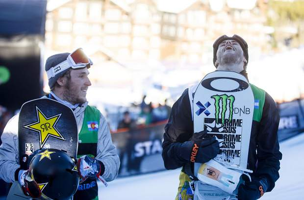 Stale Sandbech, of Norway, at right, reacts after winning Dew Tour's men's snowboard slopestyle competition on Sunday, Dec. 16, at Breckenridge Ski Resort. Chris Corning of Silverthorne, at left, placed second for the second consecutive year.