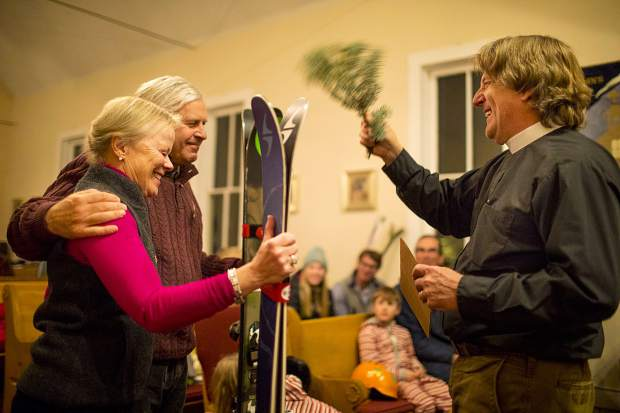 Lynette and Ric Zuch is blessed by Rev. Charlie Brumbaugh with their skis during the ceremony Wednesday, Nov. 28, at St John's Episcopal Church in Breckenridge.