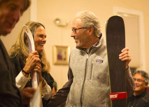 Local residents smile with their skis during the ceremony Wednesday, Nov. 28, at St John's Episcopal Church in Breckenridge.