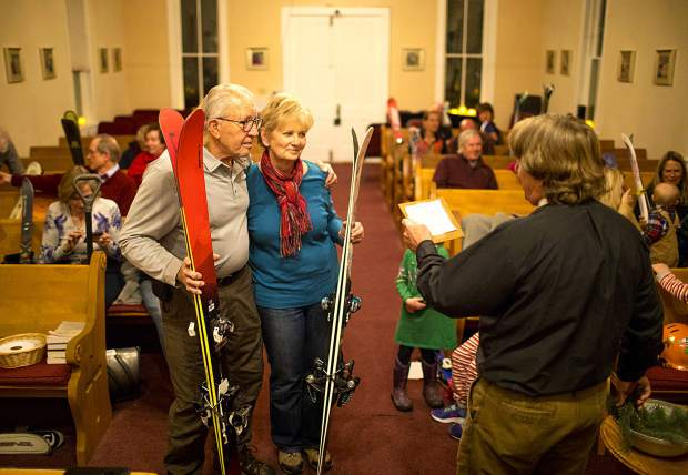 Tom and Nancy French is blessed by Rev. Charlie Brumbaugh with their skis during the ceremony Wednesday, Nov. 28, at St John's Episcopal Church in Breckenridge.