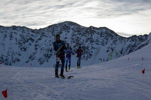 Ski mountaineering competitors transition from their uphill skins to their downhill skis during last weekend's individual ski mountaineering race at Arapahoe Basin Ski Area during the USSMA A-Basin Pan American Cup U.S. National Team qualifier races.
