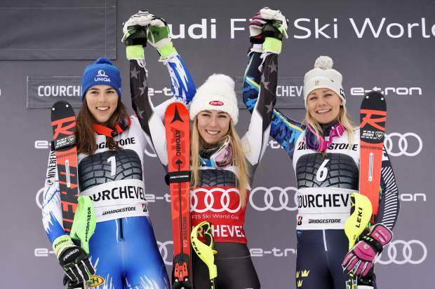 From left, second placed Petra Vlhova of Slovakia, winner Mikaela Shiffrin of the United States and third-place finisher Frida Hansdotter of Sweden celebrate on the podium of a ski World Cup women's Slalom race, in Courchevel, France on Saturday.