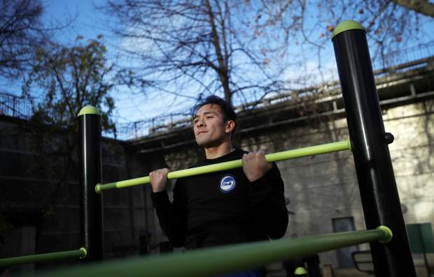 Parkour co-founder Chau Belle trains in a park in Paris on Thursday. Belle was one of nine co-founders of the street sport born in the suburbs of Paris in the 1990s. Parkour is involved in a custody battle now with gymnastics, whose leaders are trying to take the sport under their wing.