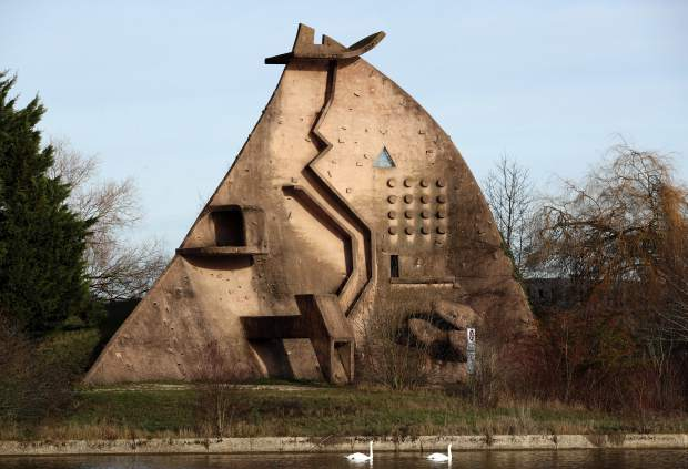 La Dame du Lac, a sculpture by Pierre Szekely is pictured in Courcouronnes, south of Paris, Tuesday, Dec. 18, 2018. The Dame du Lac climbing wall is one of the places where the founders of parkour used to train when they were inventing the street sport in the 1990s. Parkour is involved in a custody battle now with gymnastics, whose leaders are trying to take the sport under their wing. (AP Photo/Christophe Ena)
