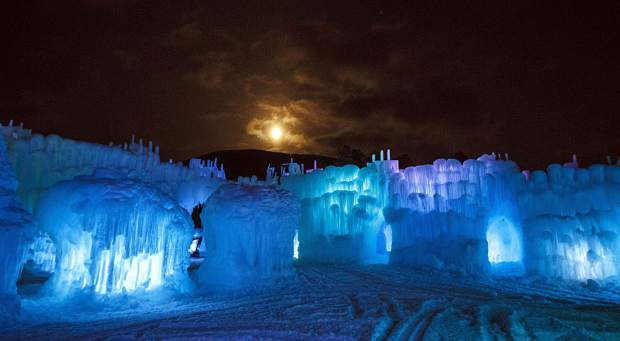 Ice Castles glow on opening night under near full-moon Friday, Dec. 21, in Dillon.