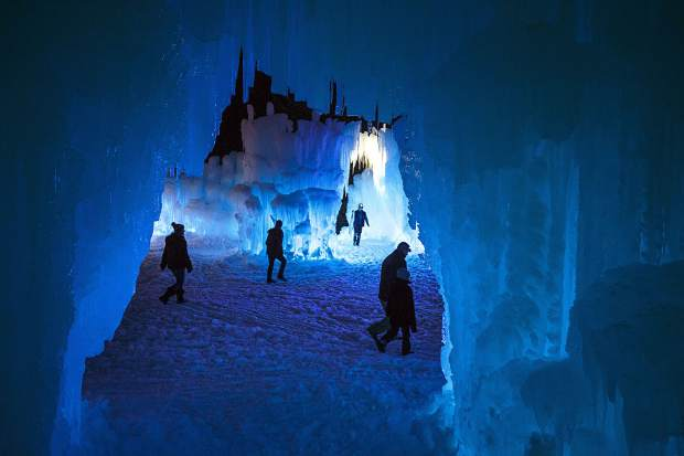 People explore the Ice Castles on the opening night, Dec. 21, 2018, in Dillon.