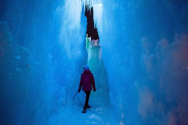 Heather Mansfield-Hom, of Frisco, explores the new Ice Castles on opening night Friday, Dec. 21, in Dillon.