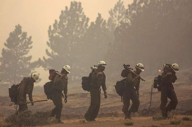 Members of the Craig Hotshots firefighters return from battling the Weston Pass Fire Monday, July 2, 2018 near Fairplay.
