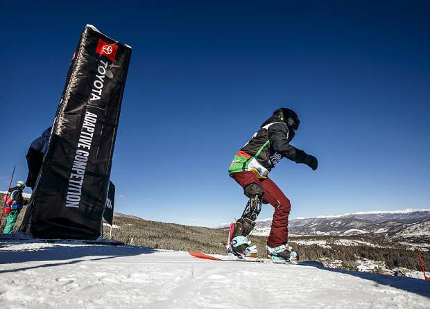 Canadian paralympian Michelle Salt takes off for the banked slalom course in the Dew Tour adaptive snowboard women's finals Thursday, Dec. 13, at Breckenridge Ski Resort, CO. Salt, who suffered a motorcycle accident in 2011 that left her on life support for one week, placed fourth in the finals.