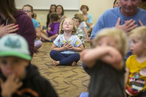 Ella Fossett, 4, in a mediating pose during a yoga class lead by Dari Johnson Tuesday, June 19, at Summit County Library's South Branch in Breckenridge. The yoga class was part of the summer long 'Libraries Rock' reading program with activities and fun for preschoolers through fifth-grade students.