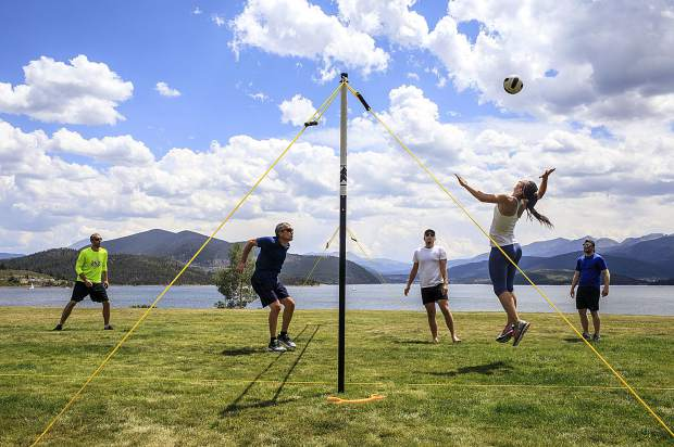 Visitors from Minnesota play a round of volleyball under comfortable summer weather near Lake Dillon Tuesday, July 24, 2018 in DIllon, CO.