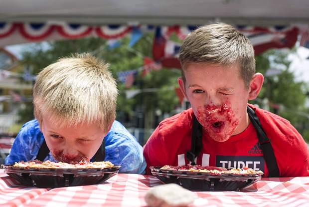 Kade Nichols, left, and his older brother, Mason, race in the Pie Eating Contest Wednesday, July 4, in the Arts District of Breckenridge.