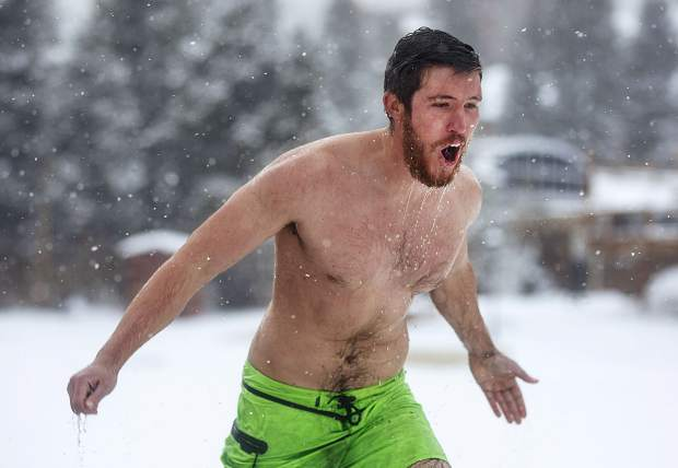 Brett Gonzenbach reacts following the dip in the Maggie Pond during the Ullr Ice Plunge Friday, Jan. 12, in Breckenridge.