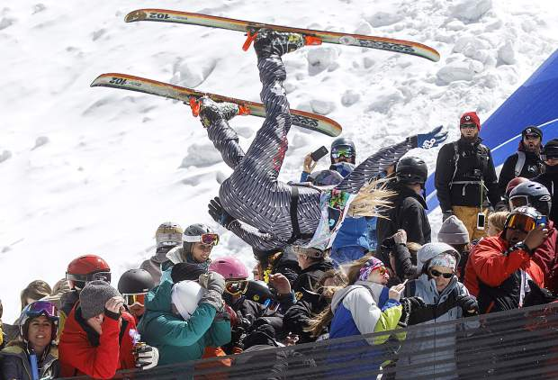 A participant of the Red Bull Slopesoakers Pond Skimming competition, Hayden Wright, 26, flies crowd from the jump during the event Saturday, April 14, 2018 at Copper Mountain, CO. The crash resulted a broken collarbone of a women spectator and several other injuries.