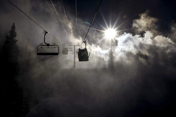 The American Eagle high-speed combination lift runs through man-made snow Tuesday, Dec. 4, at Copper Mountain, CO. The 6-person chairs and 8-person gondola cabins combination lift increases the uphill capacity to the resort's uphill capacity by more than 40 percent.
