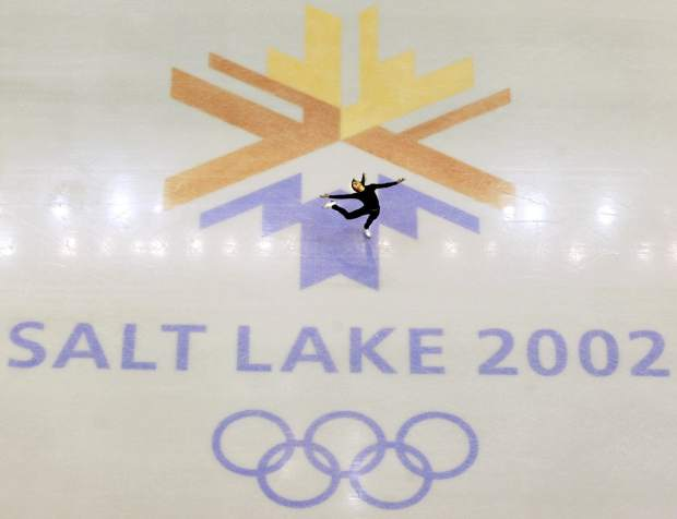 U.S. champion Michelle Kwan practices in February 2002 for the women's short program for the Winter Olympic Games at the Salt Lake Ice Center in Salt Lake City.