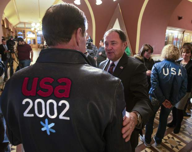Utah Gov. Gary Herbert, center, talks with Fraser Bullock, chief operating officer of the 2002 Winter Games, after the USOC choose Salt Lake over Denver to bid on behalf of the US for future Winter Games on Friday in Salt Lake City.