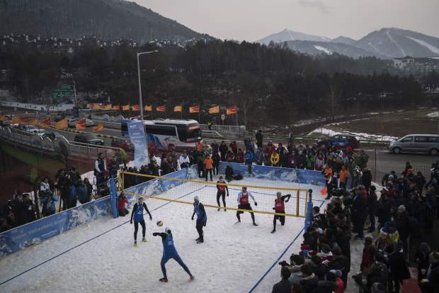 China's Xue Chen passes the ball during a snow volleyball exhibition match at Austria House in Pyeongchang, South Korea in February. When USA Volleyball asked four-time Olympian Lloy Ball to put together a team for a snow volleyball tournament in Moscow this week, the 2008 gold medalist was eager to accept. Never mind that he's never played on the snow before.