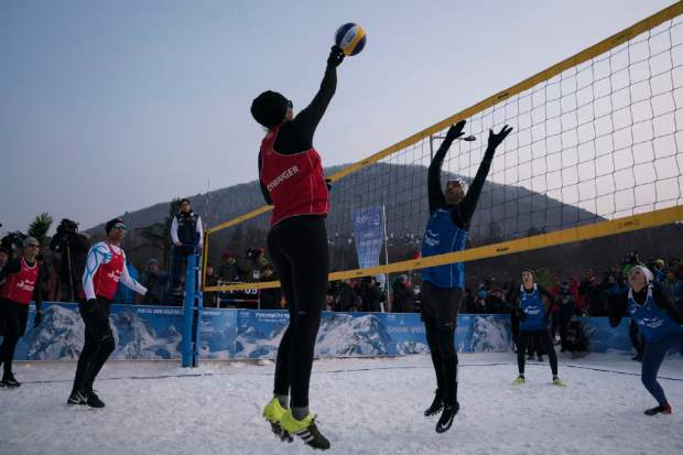 Brazil's Giba, center right, tries to block Austria's Stefanie Schwaiger during a snow volleyball exhibition match in February at Austria House in Pyeongchang, South Korea. When USA Volleyball asked four-time Olympian Lloy Ball to put together a team for a snow volleyball tournament in Moscow this week, the 2008 gold medalist was eager to accept. Never mind that he's never played on the snow before.