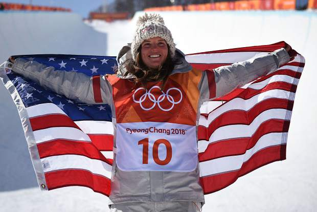 Steamboat Springs native and Breckenridge resident Arielle Gold does the traditional pose after capturing a snowboard halfpipe bronze medal in February at the 2018 Pyeongchang Winter Olympics