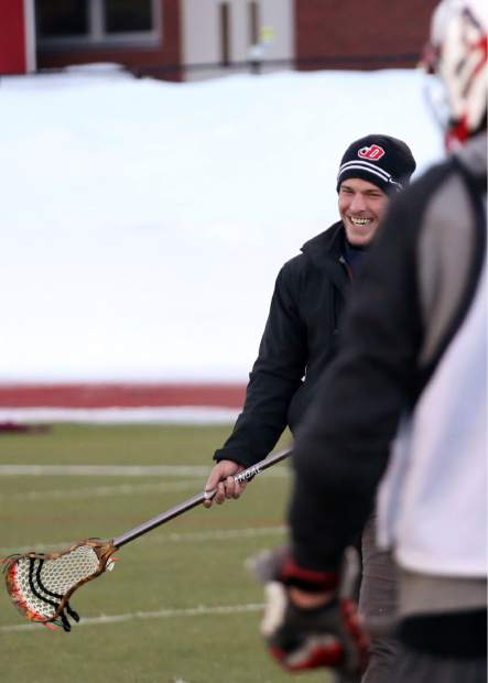 Aspen High School boys lacrosse coach Tommy Cox laughs during practice on Tuesday, Feb. 26, 2019, on the AHS turf.