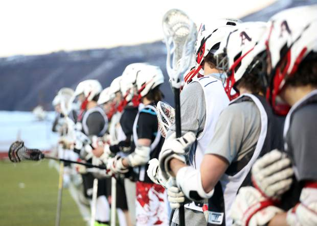 Aspen High School boys lacrosse players line up for drills during practice on Tuesday, Feb. 26, 2019, on the AHS turf.