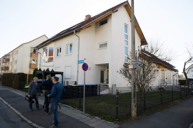 Media gather in front of a house with a doctor's office during a doping raid in Erfurt, Germany on Wednesday. Several people were arrested in doping raids in Austria and Germany during the Nordic skiing world championships.