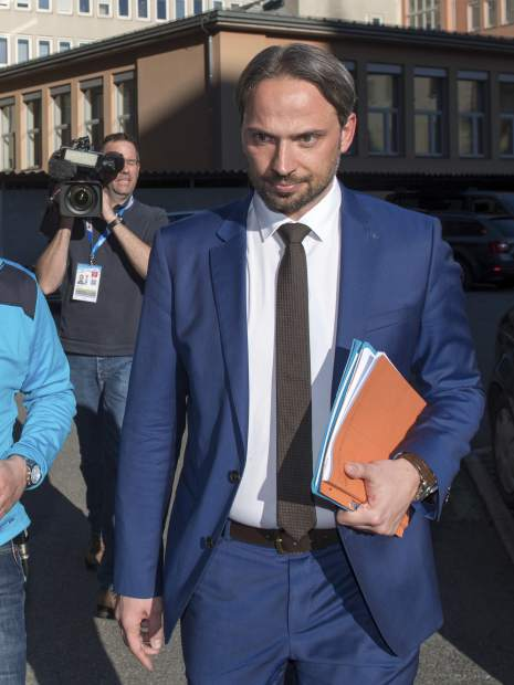 Dieter Csefan of the Austrian police returns from a the press conference about the doping raid at the Nordic World Ski Championships, in Innsbruck, Austria, on Wednesday.