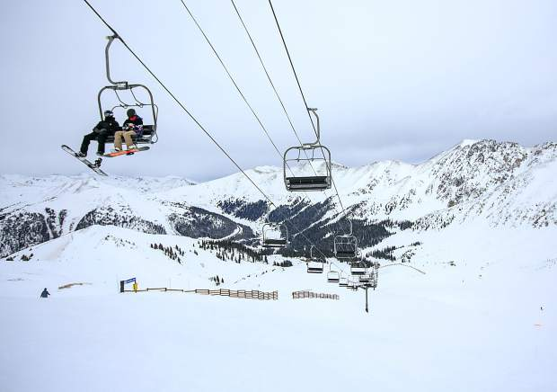 A pair of snowboarders on the chairlift at Arapahoe Basin Ski Area Monday, Feb. 18.