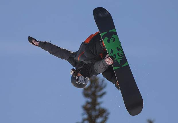 Dillon resident snowboarder Chase Blackwell, 19, grabs his Never Summer board while executing a trick in mid-air during practice on Thursday, Jan. 31, at Copper Mountain Resort. Blackwell was selected to represent the United States at next week's 2019 World Championships in Park City, Utah.