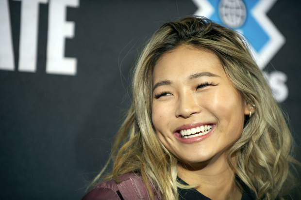 Snowboarder Chloe Kim smiles at an X Games press conference last week in Aspen, Colo. Heading to Princeton next fall, Kim is trading her board for books as she tries to blend in and become your normal college freshman.