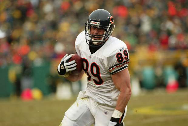 Dustin Lyman carries the football for the Chicago Bears of the National Football League during a December 2002 football game against the Green Bay Packers at Lambeau Field.