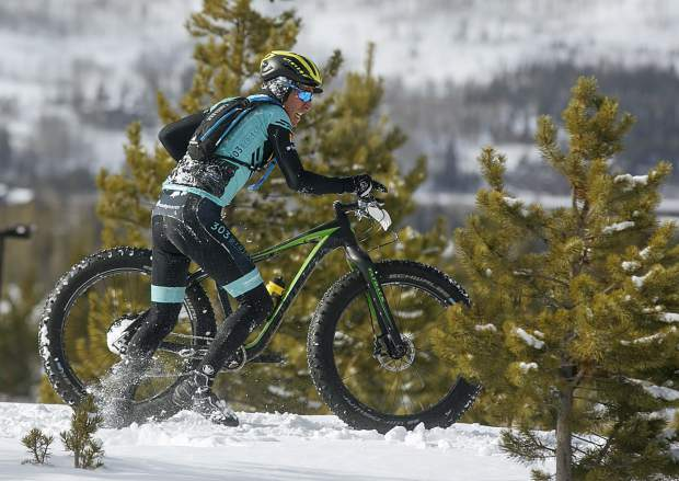 Tony Baca Soto, of Longmont, climbs back onto the packed trail after taking a fall in the snow during the third nnual Frisco Freeze Fat Bike race on Saturday, Feb. 23, on the Frisco Peninsula. Baca Soto placed second on the 14K course with a time of 43 minutes and 47 seconds.