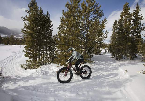 A bicyclist takes a tight turn on the snow in the 3rd Annual Frisco Freeze Fat Bike Race Saturday, Feb. 23, on the Frisco Peninsula.