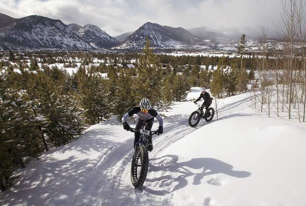 The 3rd Annual Frisco Freeze Fat Bike Race participants pedal uphill in the snow Saturday, Feb. 23, on the Frisco Peninsula.