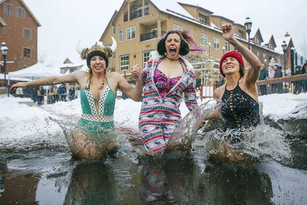 People jump into Maggie's Pond in part of Ullr Ice Plunge event Friday, Jan. 11, in Breckenridge. The 56th Ullr Fest concludes today with an ice skating party, a bike race, and a Wild and Scenic Film Festival in Breckenridge.